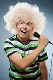Man in afrowig singing Royalty Free Stock Image
