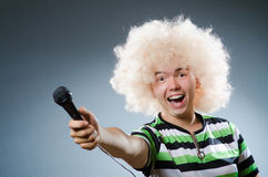 Man in afrowig singing Stock Images