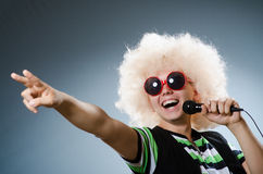 Man in afrowig singing Stock Photos