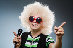 Man in afrowig singing Stock Image