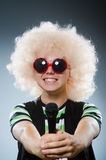 Man in afrowig singing Stock Photography