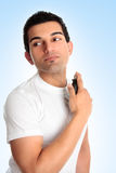 Man with aftershave cologne perfume. A guy holding and spraying a bottle of aftershave cologne perfume Stock Images