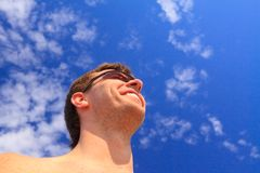 Man against the blue sky. Stock Image