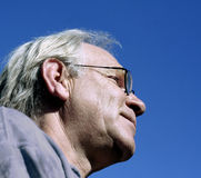 Man against blue sky. Man profile against blue clear sky royalty free stock photo