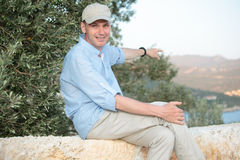 Man against olive tree. Pointing away Stock Photography