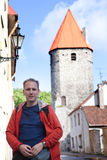 Man against towers of a city wall in Tallinn. Estonia Stock Image