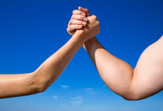 Man Against Woman in Arm Wrestling. Man and woman arm wrestling outside Stock Images