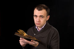 Man with a age-old books Royalty Free Stock Photography