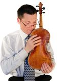 Man with a age-old  violin Royalty Free Stock Image