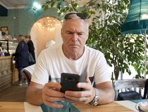 A man of age sitting in a cafe royalty free stock photo