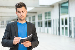 Man with agenda writing and smiling Royalty Free Stock Photos