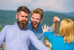 Man aggressive attacks lover of his girlfriend. Boyfriend full of jealous and aggression beating, fight with lover. Man royalty free stock photo