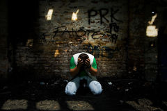 Man in agony. On his knees royalty free stock photography