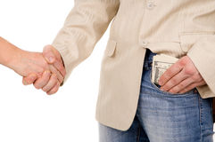 The man agreed about the bribe and puts it in his pocket Royalty Free Stock Photography