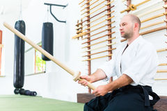Man at Aikido martial arts with wooden sword Royalty Free Stock Photography