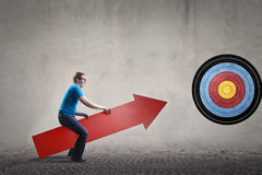 Man aiming with an arrow. Man aiming with a red arrow Stock Image