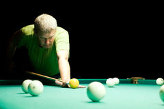 Man aiming for billiard table Royalty Free Stock Image