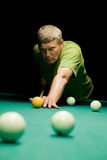 Man aiming for billiard table Stock Photos