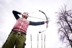 Man aiming bow Royalty Free Stock Images