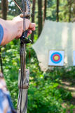 Man aiming bow at target Stock Photography
