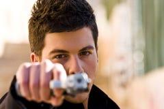 Man aiming at camera Royalty Free Stock Photo