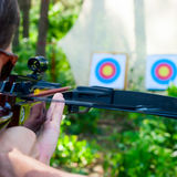 Man aiming crossbow at target Royalty Free Stock Images
