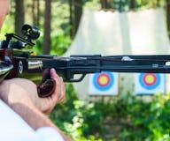 Man aiming crossbow at target Royalty Free Stock Photos