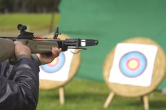 Man aiming crossbow at targets Stock Images