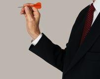 Man aiming dart at objective Royalty Free Stock Photography
