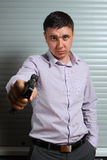 Man aiming the gun Royalty Free Stock Photo