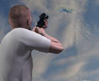 Man aiming a gun at a drone Royalty Free Stock Image
