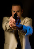 Man aiming gun at you. Private eye, killer, or gangster aims .38 revolver at you - retro style Royalty Free Stock Photography