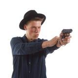 Man aiming a gun Stock Photo