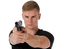 Man aiming a hand gun Royalty Free Stock Photos