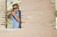 Man Aiming Hand Gun At Firing Range Stock Images