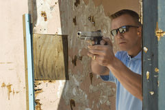 Man Aiming Hand Gun At Firing Range Stock Image