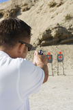 Man Aiming Hand Gun At Firing Range Stock Photography