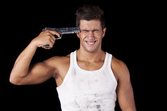 Man aiming a handgun at his head Royalty Free Stock Images
