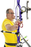 Man aiming with a longbow in closeup Stock Images
