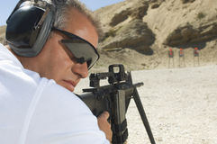 Man Aiming Machine Gun At Firing Range Royalty Free Stock Photography