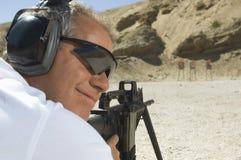 Man Aiming Machine Gun At Firing Range Royalty Free Stock Images