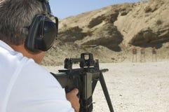 Man Aiming Machine Gun At Firing Range Royalty Free Stock Photos