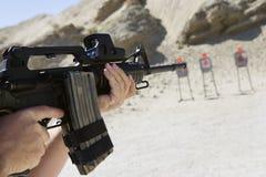 Man Aiming Machine Gun At Firing Range Stock Photos