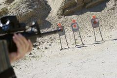 Man Aiming Machine Gun At Firing Range Stock Images