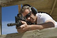 Man Aiming Machine Gun At Firing Range Royalty Free Stock Image