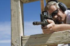 Man Aiming Machine Gun At Firing Range. During combat training Royalty Free Stock Photography