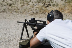 Man Aiming Machine Gun At Firing Range Royalty Free Stock Images
