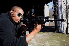 Man aiming rifle. A young man aiming a rifle Stock Images