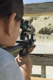 Man Aiming Rifle At Firing Range Royalty Free Stock Photography