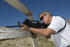 Man Aiming Rifle At Firing Range Stock Photography